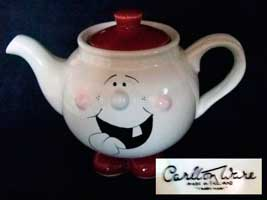 Fake face teapot with feet