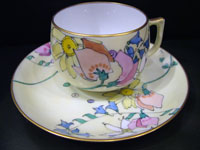 Cup & saucer decorated by Elizabeth Mary Watt