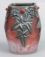 A glass vase with repoussé overlay